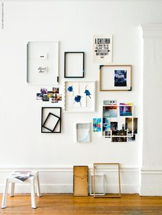 Simply hanging a variety of frames on the wall creates an interesting wall effect and center of interest. This can easily be done on any NYC apartment rental.  RDNY.com