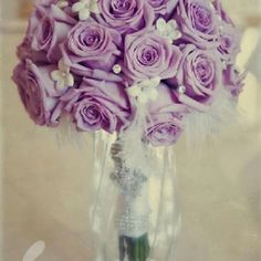 Bouquet purple sterling roses wedding flowers