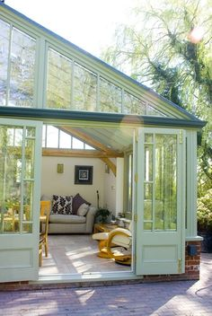 A pretty conservatory in the traditional lean-to style. Features include an oak beam, Farrow and Ball colouring and wooden cladding to the back of the building. Lean To Conservatory, Victorian Conservatory, Conservatory Design, Balcony Design, House Extension Design, House Design, Kitchen Orangery, Norway House, Orangery Extension