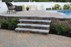 Looking to increase curb appeal? This attractive walkway features Cambridge Pavingstones with ArmorTec. Installation: Design & Build Landscape