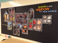 "Book Display: ""Reading is your window to a new world."" (The book covers are displayed through a variety of window shapes.)"