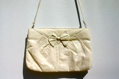 vintage 1980s white / ivory clutch purse with bow, vegan. $12.00, via Etsy.