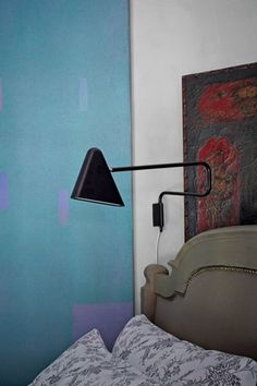 A+Seventies+abstract+painting+by+W+Nesseiz+adds+interest+in+the+bedroom