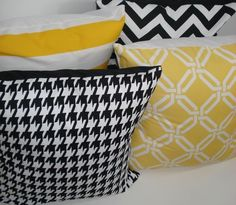 Yellow black and white pillows, love the patterns