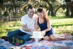 1-year anniversary photo idea! Have a photo shoot for your one-year anniversary when you cut your cake! Photos by Wedding Belles Photo of Tallahassee.