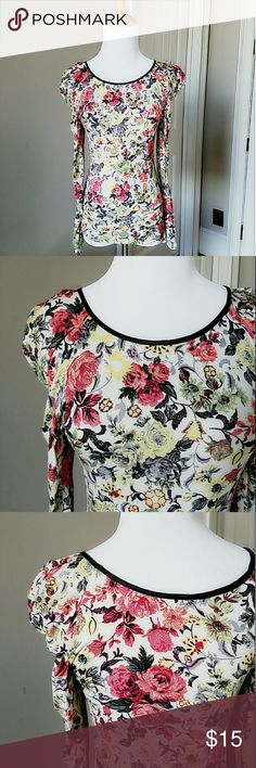 Floral print tee size xs super cute long sleeve tee with beautiful floral print size xs worn a few times, great condition Tops Tees - Long Sleeve