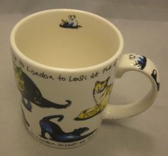 """This whimsical Paul Cardew coffee tea mug titled """"Cat Tea.""""  Cats scattered all over the mug with a cute rhyme about going to see the queen!"""