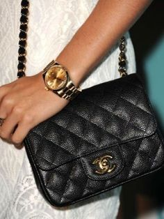 Material matters: We love the way the textured leather on Ashley Tisdale's tiny Chanel bag catches the light.