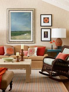 Warmth of Red  Fall-inspired decor encompasses both color and texture. The poppy-red and burnt orange accents in this living room enhance the space's neutral oeuvre, which shows itself in walls covered in grass cloth, linen-covered furniture, and a wicker rocking chair.