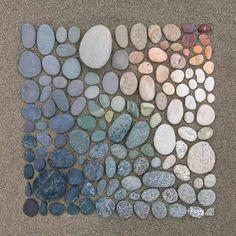 Gradient colour pebble arrangement.
