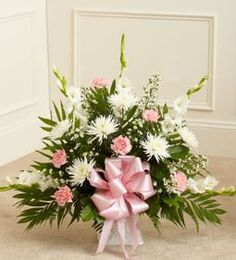 Tribute Pink & White Floor Basket Arrangement When words aren't enough to convey all you feel at this difficult time, let our beautiful floor basket arrangement help you express your feelings perfectl