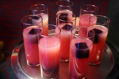Treat guests to a custom cocktail at your reception, like this colorful honey vodka lemonade with blueberry ice cubes.