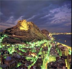 Alicante, Spain. I lived here in 2006 and we used to climb all the way to the top and drink wine with the locals before going out.