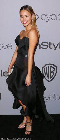 So glam: Jamie Chung looked gorgeous in a strapless prom-style dress with layered skirt...