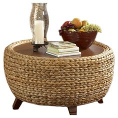 Drum coffee table with plaited seagrass sides and a wood top.  Product: Coffee tableConstruction Material: Wood and s...