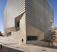 Completed in 2013 in Ceuta, Spain. Images by Fernando Alda , Manuel García de Paredes. The new Library in Ceuta is conditioned by the steep topography of the plot and by the Arab Marinid archaeological excavation of the XIV century that. A As Architecture, Contemporary Architecture, Amazing Buildings, Modern Buildings, Architectural Photographers, Facade Design, Built Environment, Building Design, Construction