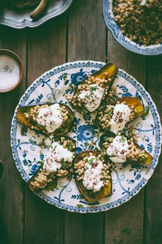 Eggplants stuffed with Israeli cous cous and topped with Greek yoghurt and sumac