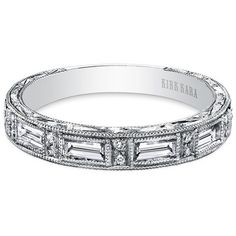 "Kirk Kara ""Charlotte"" Diamond Baguette Wedding Ring Featuring 0.42 Carats Baguette Cut Diamonds and 0.08 Carats Round Cut Diamonds in 18kt White Gold . Style SS6685D-B · What Sparkles Most Is You"