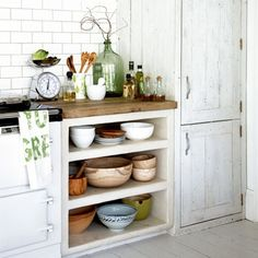 Rustic kitchen storage Distressed furniture is the perfect way to add a vintage, rustic feel to a white kitchen, instantly giving it character. Keeping oils, vinegars and blending bowls together on d (Cool Kitchen Storage) White Kitchen Storage, Rustic Kitchen Storage, Home Kitchens, Rustic Kitchen, Kitchen Remodel, Kitchen Design, Country Kitchen, New Kitchen, Kitchen Storage