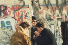 "lt-rik: "" A soldier of East german grenztruppen lights a cigarette at the fall of Berlin wall, 1989-1990. """
