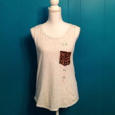 NWT PINK gray tank Brand new VS PINK heathered gray tank with leopard print pocket. Curved bottom, elongated arm holes and dog icon embroidered on the bottom. No trades. PINK Victoria's Secret Tops Tank Tops