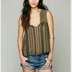 Free People embroidered STRIKE IT open back tank What a sweet top! The open back has ties around the bust and neck. V-Neck styling in the front and pintuck on bust. Embroidery throughout. Raw trim.   *FP One is an exclusive collection made with love from India. Defined by bold embellishments and natural-feeling fabrics, the collection brings a modern twist to old world techniques.    *100% Cotton  *Hand Wash Cold  *Import  Measurements for Small: Bust: 33? = 83 7/8 cm Length: 21 3/4? = 55…