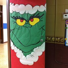 In an effort to avoid recovering the door since Halloween, we transformed Frankenstein into the Grinch!!