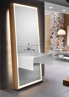 all in one mirror, sink, faucet and lighting. clean, functional and beautiful. although it looks movable, plumbing would make it stationary.