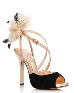 Adorned with a feathery flourish at the ankle, everything about this shoe spells drama. With an enviable height, smoldering straps in luminous metallic rose gold leather and a sumptuous black suede peep-toe, they're the statement heels we can't wait to wear with just about every dress in our closet.