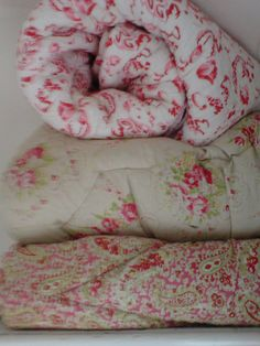 pink vintage eiderdowns and comfy quilt