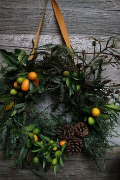 Fresh citrus kumquats for a cheery orange and green holiday wreath. 18 Breathtaking Christmas Door Wreaths That Are Begging To Be Stolen By Neighbors — DESIGNED w/ Carla Aston Noel Christmas, All Things Christmas, Winter Christmas, Christmas Crafts, Christmas Decorations, Holiday Decor, Natural Christmas, Elegant Christmas, Christmas Images