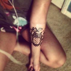 Black Ink Owl Tattoo On Girl Left Forearm