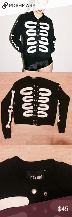 LAZY OAF SKELETON BOMBER JACKET s/m m/l Absolutely beautiful lazyoaf skeleton print in the front with push button closure and two side pockets. In great condition with no break in the print, but a small black mark in the last right rib as seen in picture (not that noticeable) size medium/large but I wear an extra small and this fits me perfectly so would fit small/medium too. Tags: Unif dollskill topshop dolls kill asos kill star killstar Esther loves Lazy Oaf Jackets & Coats Utility Jackets