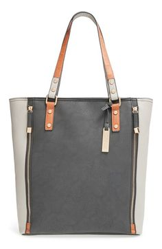 Free shipping and returns on Cesca 'Mandra' Tote at Nordstrom.com. Decorative vertical zippers bracket a color-blockedtote topped with easy over-the-shoulder handles.