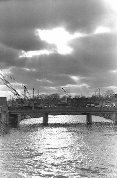 The Harrison Street bridge, and the Flint River, before the construction of Riverbank Park. Flint, Michigan, Circa 1977.