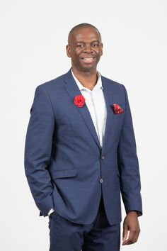 Smiling South African business man in dark blue suit with red pocket handkerchief and red flower boutonniere / buttonhole. Portrait of new CEO of Consulta, Philani Dlamini, September 2018 Dark Blue Suit, Pocket Handkerchief, Photography Office, Canon, Suit Jacket, Portrait, Photographers, September, Jackets