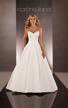 A-line wedding dresses from Martina Liana featuring side pockets and wide pleating. Comes in fabrics including Deluxe Dupioni, Duchess Silk Satin, Silk Taffeta and Silk Zibeline. #MartinaLiana #weddingdress