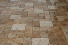 Travertine Pavers or the like. Pavers on a pool deck just lend it great texture.