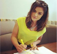 Lucy Hale; short-medium hairstyle in a beachy look