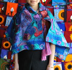 The fabric for this cape was woven on the backstrap loom. The floral designs are machine embroidered. From Zinacantan, a tzotzil maya town in the highlands of Chiapas Mexico