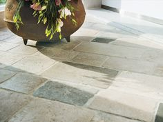 COBBLESTONE DE FRANCE | Made up of tiles in complementary greys, browns, and charcoals, this rustic, tumbled French limestone is inspired by the historic cobblestone streets of Paris. Ideal for exterior applications, it also makes a charming and durable indoor floor. View this stone along with our other stunning surfaces in our new 2018 lookbook! francoisandco.com/lookbook