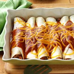 Beef n Rice Enchiladas Recipe from Taste of Home -- shared by Jennifer Smith of Colona, Illinois