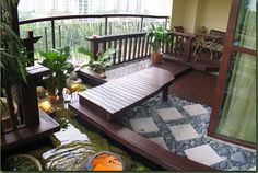Choosing the Nice Balcony Design: Balcony Design With Japanese Garden Design And Small Ponds With Potted Trees Also Dark Wood Flooring And Wood Corner Tables Cool House Decorations ~ sagatic.com Balcony Inspiration