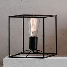 The Beacon Lighting Itlas 1 Light metal table lamp in black.