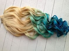 Blonde ombre, dip dye of everything wonderful. Mermaid hair with a slow blue fade diving straight into the ocean.  Indian Remy human hair, hand drawn and double wefted.   We use only Professional methods and materials. Our extensions are AAA quality and color used is Professional that has ext...
