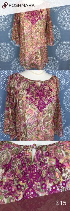 """RHE Hatco Dress w/ Embroidery and Bell Sleeves Cute paisley patterned dress in pinks, greens, yellow and beige. The front has a pretty, dark pink floral embroidery. There is also a keyhole opening with a button closure. The bodice is lined, and the bell sleeves are sheer with elastic in the middle. Could also be worn as a tunic top. Great condition. 19"""" armpit to armpit and 32"""" long. RHE Hatco Dresses"""