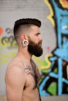 Great beard, tattoos and beard not sure about the earring.