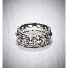 I want this as a wedding ring set. plus another band or two? maybe one with a small solitaire or triple? I'm in love!
