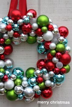 a wreath made with ornaments--helpful tip: wrap wreath form with ribbon before gluing on any ornaments . . . place all the ornament hooks pointing downwards . . .