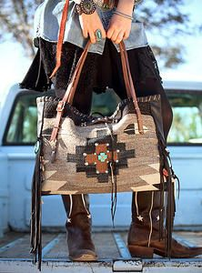 Ooo So Santa Fe Handbags & Totes Santa Fe New Mexico All of my bags are made by hand and each is one-of-a-kind, incorporating a combination of retired vintage Navajo blankets / rugs, vintage or gently-used horse tack, and deer, elk or cowhide leathers. I embellish the bags with vintage trade beads, turquoise, coral, nickel silver/German silver Concho buttons, nickel silver spots/studs, and deer antler tips.